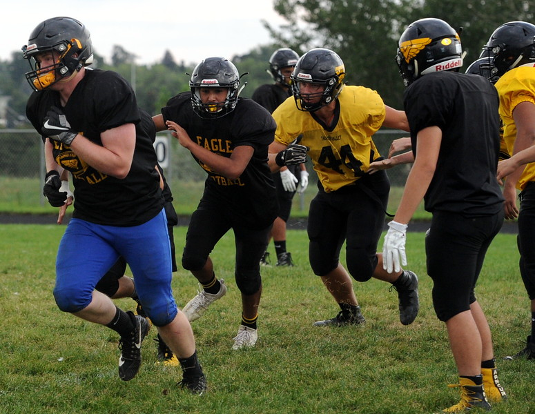 Members of the Thompson Valley football team work on a punt drill during a recent practice at TVHS.