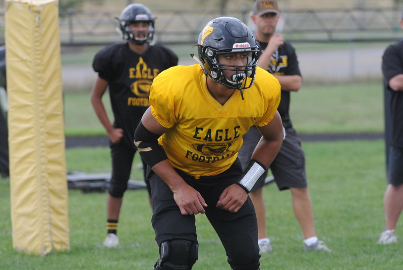 Senior Kanaan Turnbull eyes the offense during a goal-line drill during a recent practice at TVHS.