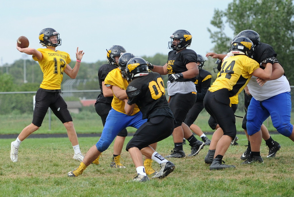 . Quarterback Ti Smack (12) winds up to throw during a recent Thompson Valley football practice.