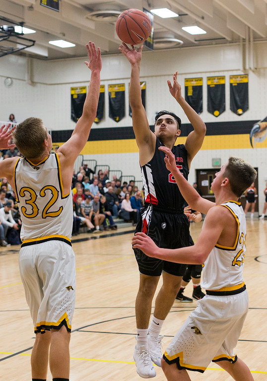 . Loveland\'s Julian Moya (25) gets a shot in the lane against the Thompson Valley defense Saturday evening Jan., 13, 2018 at Thompson Valley High School in Loveland. The home-team Eagles beat the Indians 69-50. (Photo by Michael Brian/Loveland Reporter-Herald)