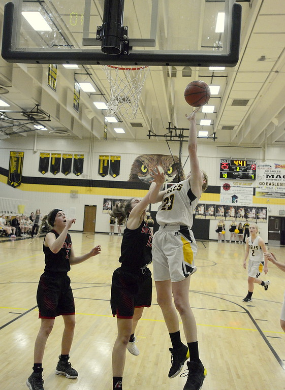. Thompson Valley\'s Dydnee Durtsche goes over Loveland\'s Claira Gilchrist for a basket during Saturday\'s crosstown game at the TVHS gym. Durtsche led the Eagles with 15 points in their 58-54 win.