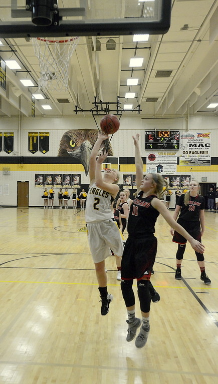 . Thompson Valley\'s Novi Briggs sneaks inside for a layup against the defense of Loveland\'s Lexi Eberhardt during their game Saturday at TVHS. Briggs made five of six free throws in the final minute to secure a 58-54 win for the Eagles.