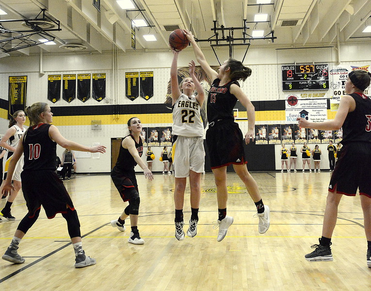 Loveland's Claira Gilchrist bloks the shot of Thompson Valley's Dani Sobraske in Saturday's crosstown matchup at the TVHS gym. The Eagles won 58-54.
