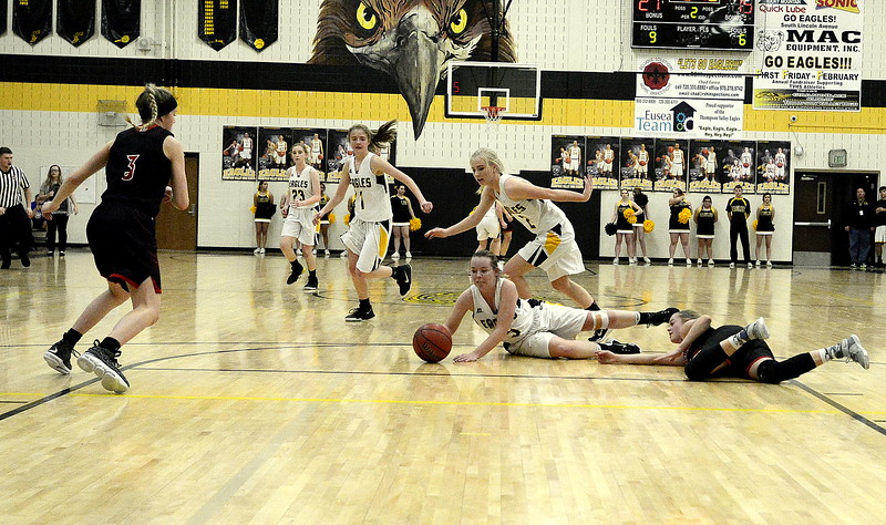 Thompson Valley's Shea Schuetz wins the race to a loose ball during Saturday's game with Loveland. The Eagles came out fast and showed poise late in winning the crosstown rivalry game over the Indians 58-54.