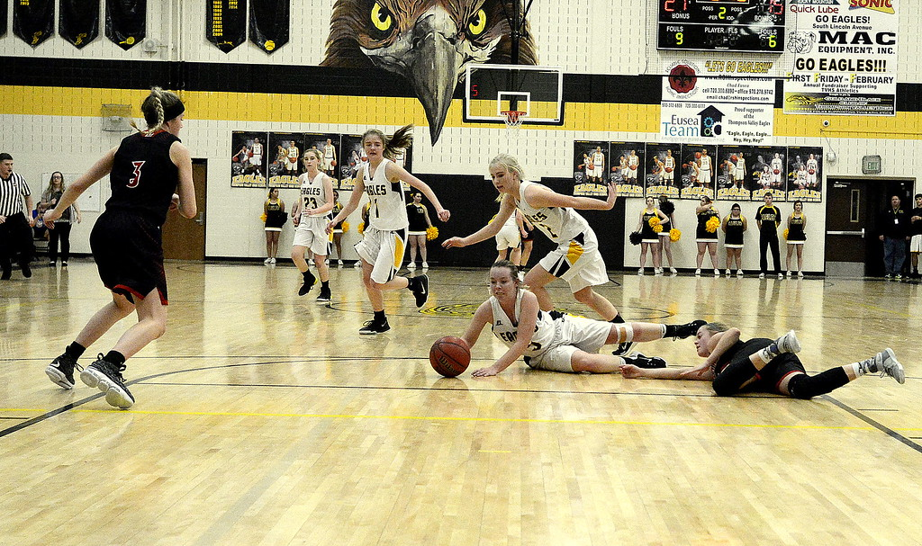 . Thompson Valley\'s Shea Schuetz wins the race to a loose ball during Saturday\'s game with Loveland. The Eagles came out fast and showed poise late in winning the crosstown rivalry game over the Indians 58-54.