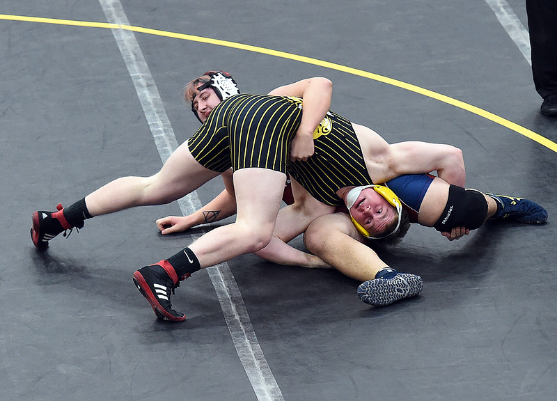 Thompson Valley's Chris Ringus wrestles Northridge's Zeus Manzanares during their 220 pound match Thursday, Jan. 19, 2017, at Thompson Valley High School in Loveland. (Photo by Jenny Sparks/Loveland Reporter-Herald)
