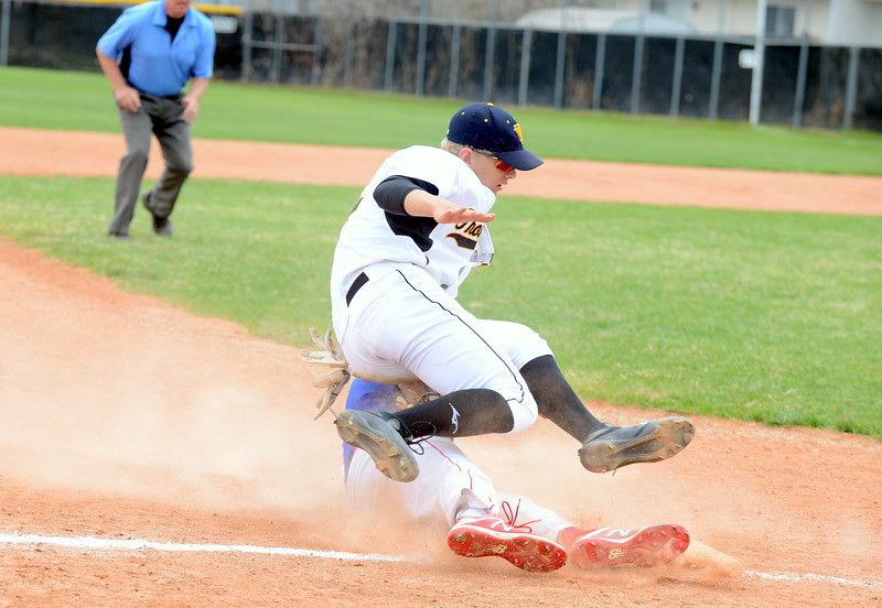 Thompson Valley third baseman Brock Nellor has his feet taken up from under him by the slide of Centaurus' Channing Cowen in the third inning of Saturday's game with Centaurus at Constantz Field. Cowen was out on the play. (Mike Brohard/Loveland Reporter-Herald)