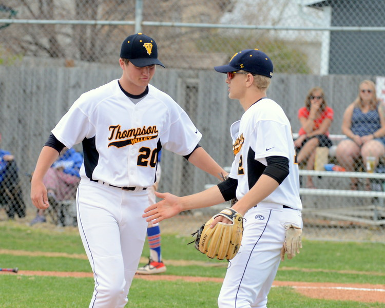 Thompson Valley pitcher Aidan Schultz is congratulated by third baseball Brock Nellor after escaping a first-inning jam with a strikeout in Saturday's game with Centaurus at Constantz Field. (Mike Brohard/Loveland Reporter-Herald)