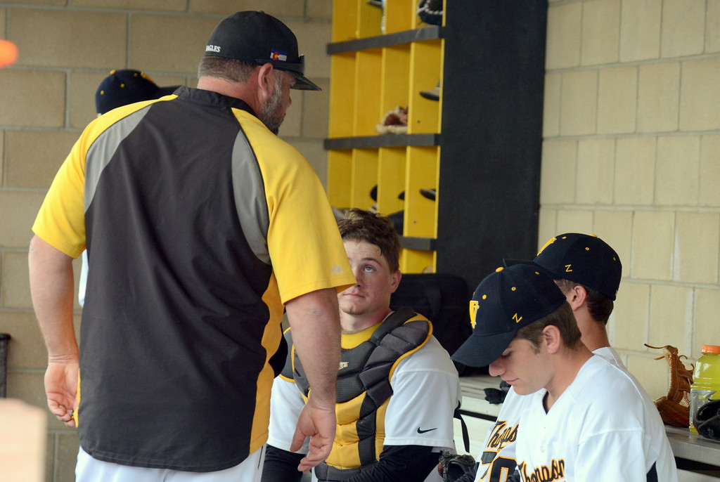 . Thompson Valley pitching coach Chad Raabe talks with catcher Trenten Riehl and pitcher Aiden Schultz in the dugout during Saturday\'s game with Centaurus at Constantz Field. (Mike Brohard/Loveland Reporter-Herald)