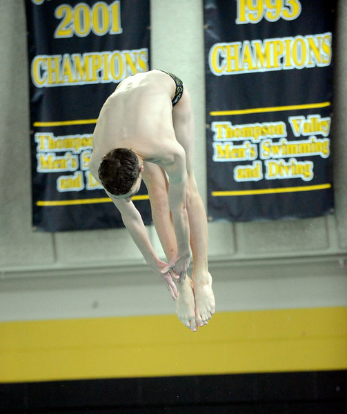Thompson Valley diver Isaac Chase starts to come out of his pike during Thursday's Northern Conference dual with Longmont at the Dick Hewson Aquatic Center. (Mike Brohard/Loveland Reporter-Herald)