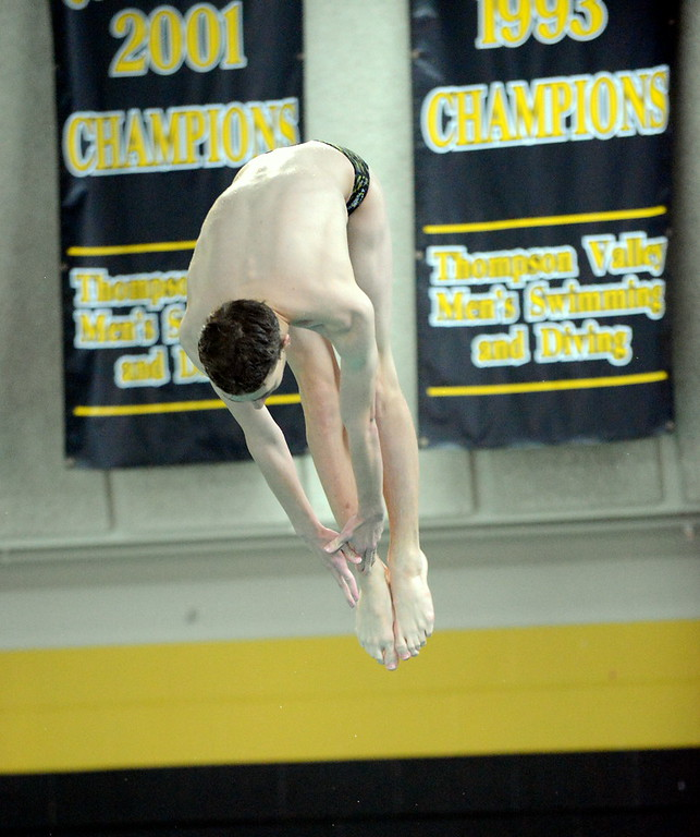 . Thompson Valley diver Isaac Chase starts to come out of his pike during Thursday\'s Northern Conference dual with Longmont at the Dick Hewson Aquatic Center. (Mike Brohard/Loveland Reporter-Herald)