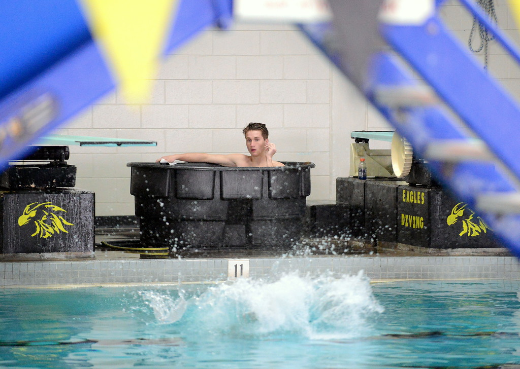 . Thompson Valley diver Logan Brian sits in the tub and watches as his teammates warm up during Thursday\'s Northern Conference dual with Longmont at the Dick Hewson Aquatic Center. (Mike Brohard/Loveland Reporter-Herald)