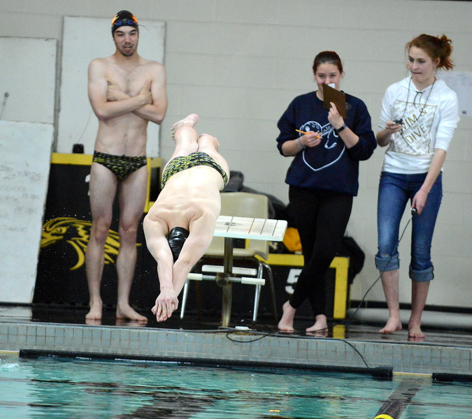 Thompson Valley's Jake Axelson comes off the block at the start of the 50-yard freestyle in Thursday's Northern Conference dual with Longmont at the Dick Hewson Aquatic Center. (Mike Brohard/Loveland Reporter-Herald)