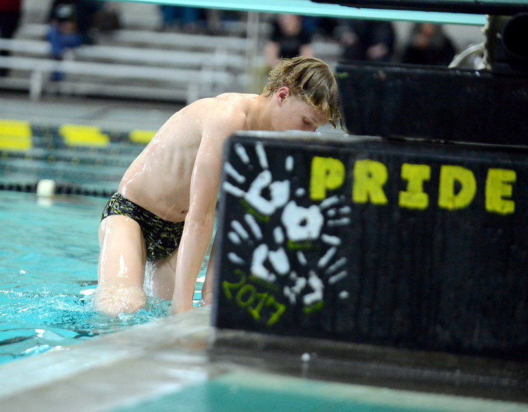 Thompson Valley diver Joe Smack climbs out of the pool after completing a dive during Thursday's Northern Conference dual with Longmont at the Dick Hewson Aquatic Center. (Mike Brohard/Loveland Reporter-Herald)