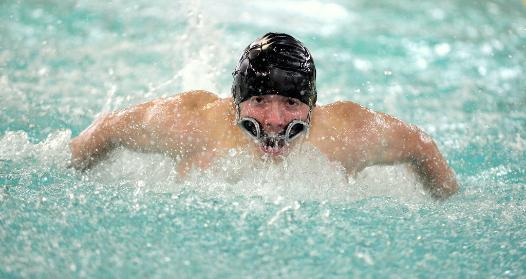 . Thompson Valley\'s Donovan Love, whose goggles dropped down as soon as he dove in,  finishes out the 100-yard butterfly in Thursday\'s Northern Conference dual with Longmont at the Dick Hewson Aquatic Center. (Mike Brohard/Loveland Reporter-Herald)