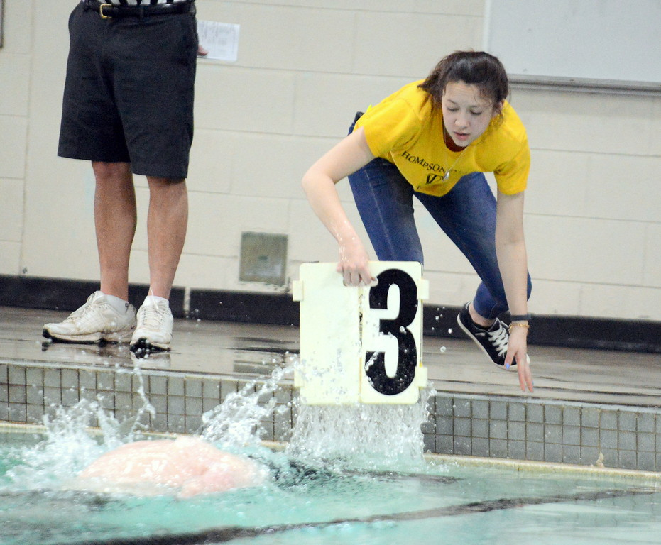 . Thompson Valley manager Paityn Saldana starts to back away to avoid the splash from Calvin Faller\'s turn as she counts for him during the 500-yard freestyle at Thursday\'s Northern Conference dual with Longmont at the Dick Hewson Aquatic Center. (Mike Brohard/Loveland Reporter-Herald)