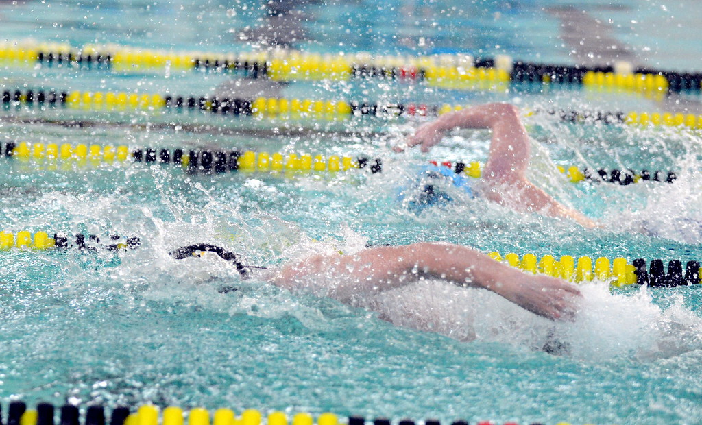 . Thompson Valley\'s Ben Smith surges past Longmont\'s James Sears as the Eagles came from behind to win the 400-yard freestyle at Thursday\'s Northern Conferdnce dual  at the Dick Hewson Aquatic Center. (Mike Brohard/Loveland Reporter-Herald)
