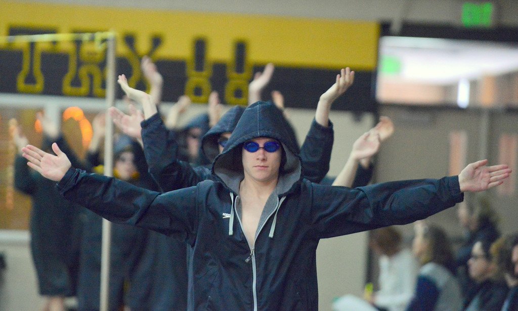 . Captain Jake Axelson leads Thompson Valley\'s boys swim team on to the deck for Thursday\'s Northern Conference dual with Longmont at the Dick Hewson Aquatic Center. (Mike Brohard/Loveland Reporter-Herald)