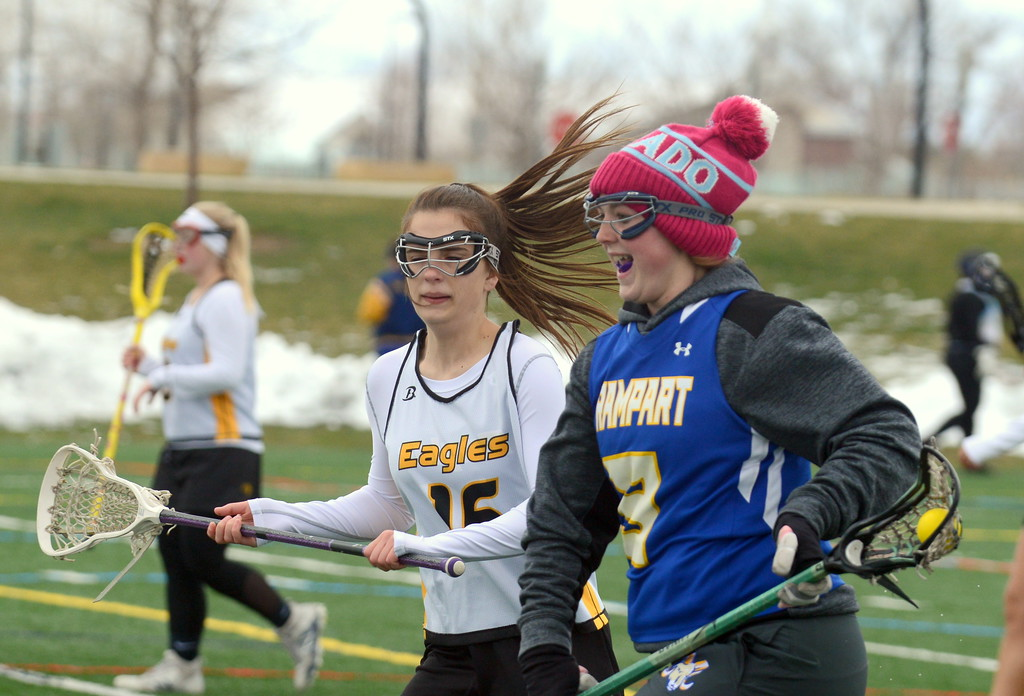 . Thompson Valley\'s Olivia Brock (16) chases Rampart\'s Caitlyn Tabeling during Saturday\'s game  at Loveland Sports Park. (Mike Brohard/Loveland Reporter-Herald)