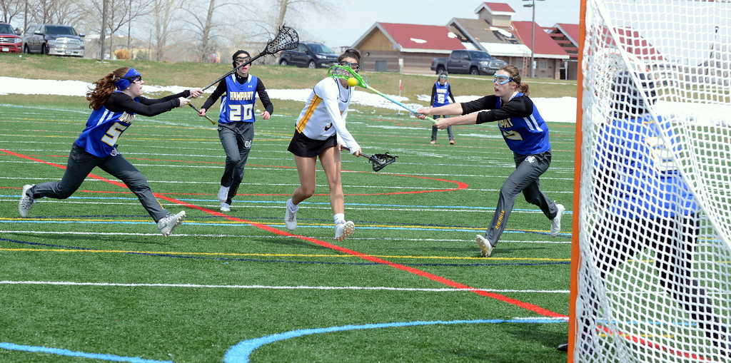 . Thompson Valley\'s Isabel Shannon lets rip a shot for the game-winning goal in Saturday\'s 16-15 victory over Rampart in sudden-death overtime at Loveland Sports Park. Shannon tallied six goals in the contest. (Mike Brohard/Loveland Reporter-Herald)