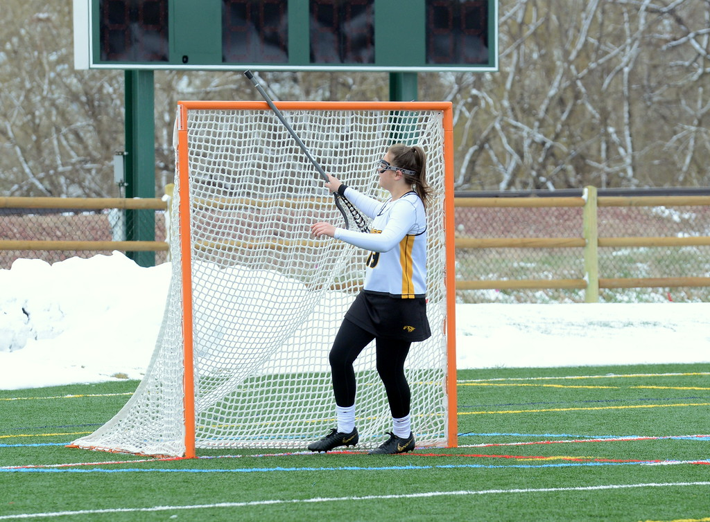 . Thompson Valley\'s Nicola Hanekom taps the pipes of the net with her stick as she enters the field prior to the start of Saturday\'s game with Rampart at Loveland Sports Park. (Mike Brohard/Loveland Reporter-Herald)