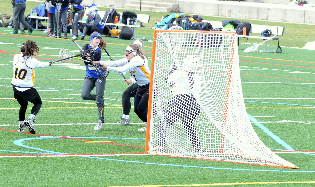 . Rampart\'s Mackenzie Dudevoir (5) fires a shot high as Thompson Valley defenders Kiara Demare (1) and Faith Selesnke (7) apply pressure during Saturday\'s game  at Loveland Sports Park. (Mike Brohard/Loveland Reporter-Herald)