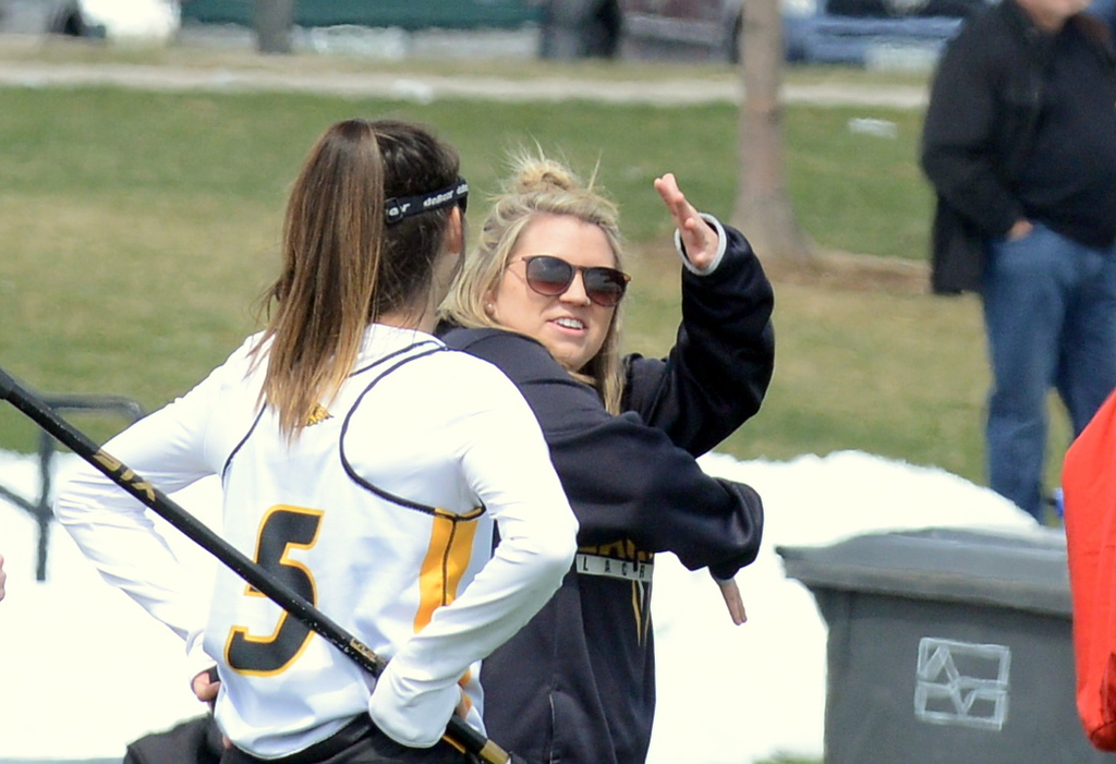 . Thompson Valley coach Kaila Stassi talks with Isabel Shannon on the sidelines in a break from play during Saturday\'s game with Rampart at Loveland Sports Park. (Mike Brohard/Loveland Reporter-Herald)