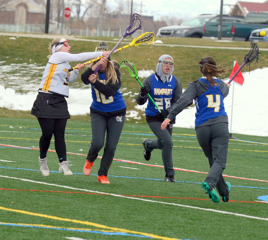 . Thompson Valley\'s Ashlyn Coley gets a shot off as Rampart\'s Amelia Peterson (10) defends during Saturday\'s game  at Loveland Sports Park. (Mike Brohard/Loveland Reporter-Herald)
