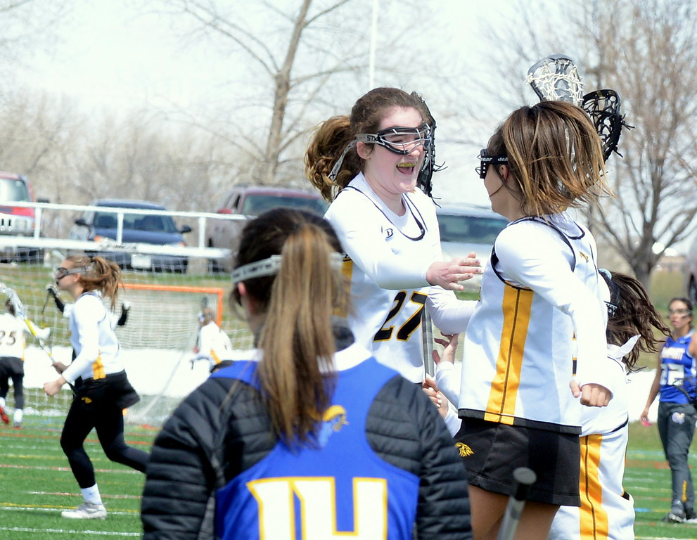 . Thompson Valley\'s Annaliese Carr (left) and Isabele Shannon celbrate Shannon\'s game-winning goal in a 16-15 overtime win over Rampart Saturday at Loveland Sports Park. (Mike Brohard/Loveland Reporter-Herald)