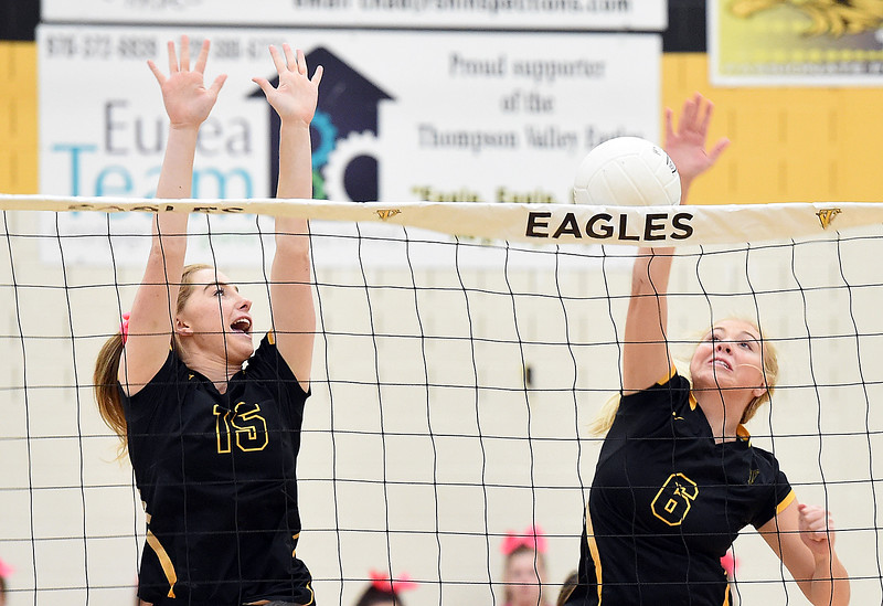 Thompson Valley's (15) Sydnee Durtsche and (6) Danielle Sobraske try to block the ball during their game against Mountain View Thursday, Oct. 11, 2018, at Thompson Valley school in Loveland. (Photo by Jenny Sparks/Loveland Reporter-Herald)