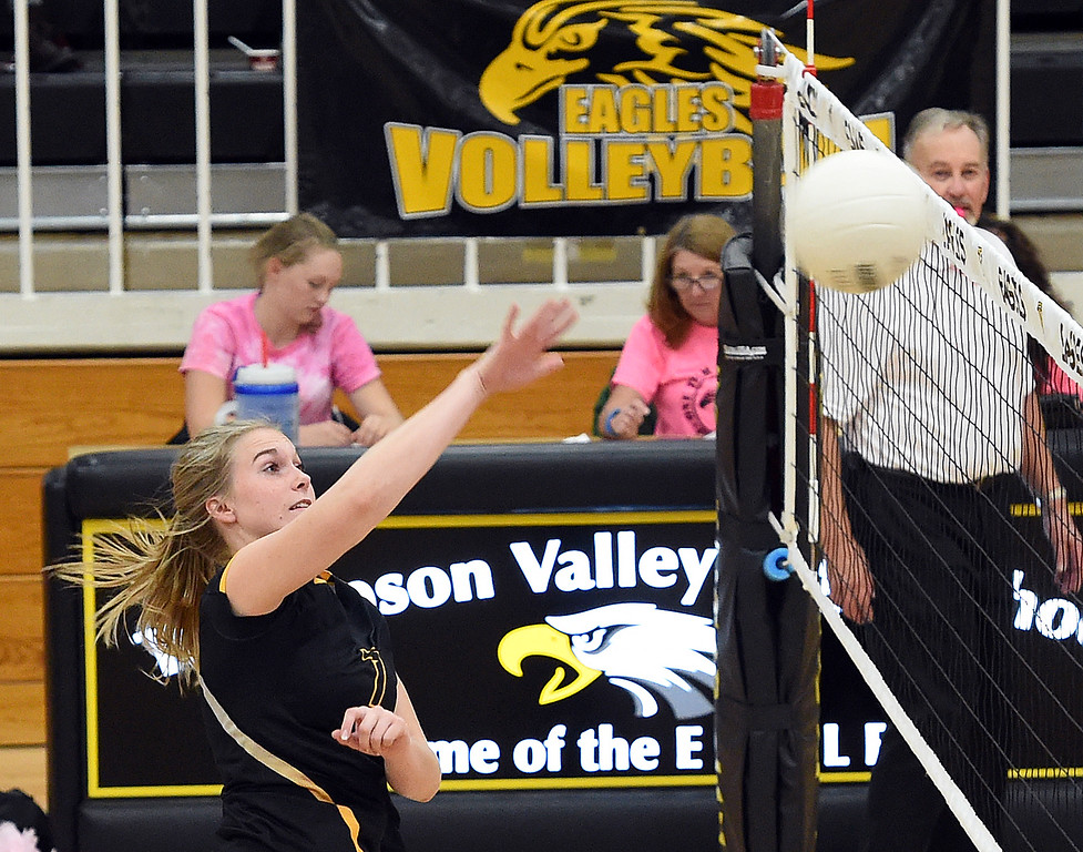 . Thompson Valley\'s (7) Charleigh Cooper spikes the ball during their game against Mountain View Thursday, Oct. 11, 2018, at Thompson Valley school in Loveland. (Photo by Jenny Sparks/Loveland Reporter-Herald)