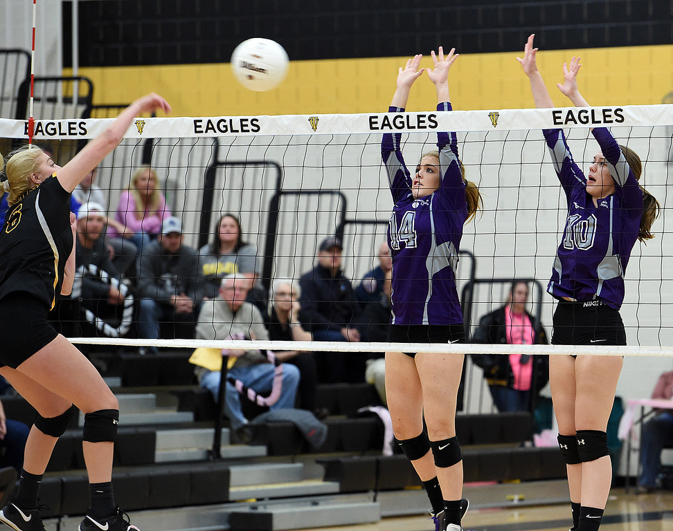 . Mountain View\'s (14) Sidney Boudrero and (10) Megan Hurr try to block as Thompson Valley\'s (6) Danielle Sobrask spikes the ball during their game Thursday, Oct. 11, 2018, at Thompson Valley school in Loveland. (Photo by Jenny Sparks/Loveland Reporter-Herald)