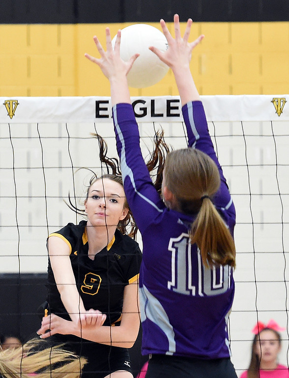 . Thompson Valley\'s (9) Elease Marolf spikes the ball as Mountain View\'s (10) Megan Hurr tries to block during their game Thursday, Oct. 11, 2018, at Thompson Valley school in Loveland. (Photo by Jenny Sparks/Loveland Reporter-Herald)