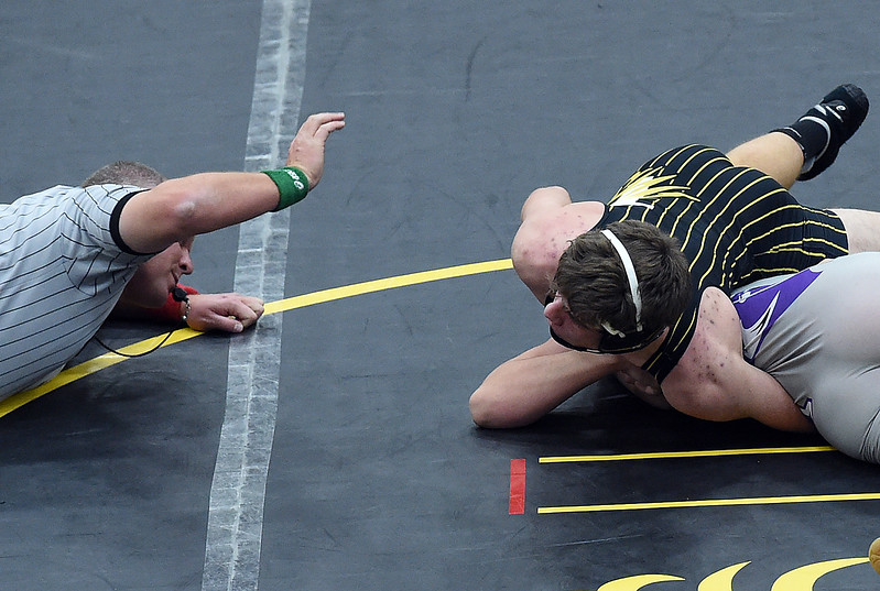 Thompson Valley's Chase Englehardt pins Mountain View's Kory Kass during their 160 pound match Thursday, Jan. 13, 2017, at Thompson Valley High School in Loveland.  (Photo by Jenny Sparks/Loveland Reporter-Herald)