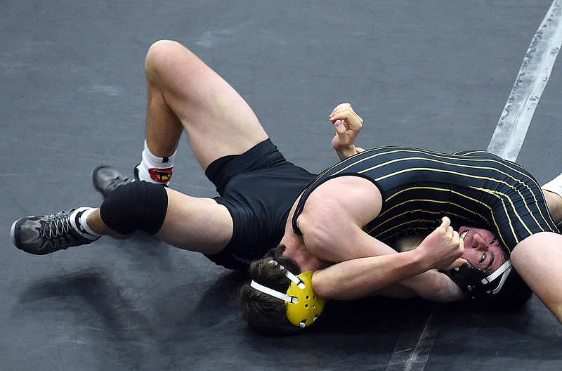 Thompson Valley's Zach Kennison wrestles Mountain View's Tyler Harshman during their 138 pound match Thursday, Jan. 13, 2017, at Thompson Valley High School in Loveland. Kennison won the match. (Photo by Jenny Sparks/Loveland Reporter-Herald)<br /> <br /> 138 tv win