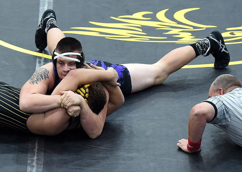 Mountain View's Martin Rodriguez wrestles Thompson Valley's Chris Ringus during their 220 pound match Thursday, Jan. 13, 2017, at Thompson Valley High School in Loveland. Rodriguez won the match. (Photo by Jenny Sparks/Loveland Reporter-Herald)
