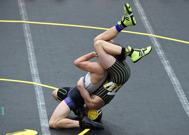 Thompson Valley's Hunter Williams wrestles Mountain View's Jackson Gilbert during their 152 pound match Thursday, Jan. 13, 2017, at Thompson Valley High School in Loveland. Williams won the match. (Photo by Jenny Sparks/Loveland Reporter-Herald)