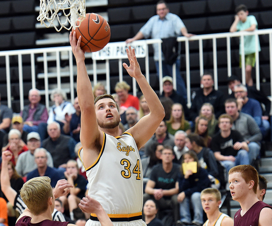 Thompson Valley's (34) Joey Shaffer goes up for a shot during their game against Berthoud High on Tuesday, Dec. 19, 2017, at Thompson Valley in Loveland.   (Photo by Jenny Sparks/Loveland Reporter-Herald)
