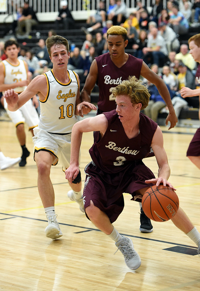 Berthoud's (3) Curtis Peacock turns to take the ball down court during their game against Thompson Valley Tuesday, Dec. 19, 2017, at Thompson Valley in Loveland.   (Photo by Jenny Sparks/Loveland Reporter-Herald)