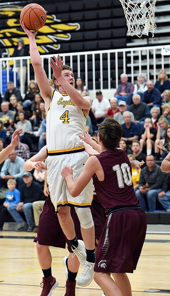 Thompson Valley's (4) Paul Pomerleau goes up for a shotduring their game against Berthoud Tuesday, Dec. 19, 2017, at Thompson Valley in Loveland.   (Photo by Jenny Sparks/Loveland Reporter-Herald)