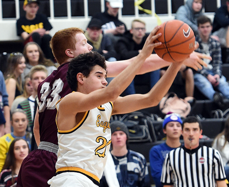 Thompson Valley's (23) Jaromy Morgan and Berthoud's (33) Benjamin Burkett go up for a rebound during their game Tuesday, Dec. 19, 2017, at Thompson Valley in Loveland.   (Photo by Jenny Sparks/Loveland Reporter-Herald)