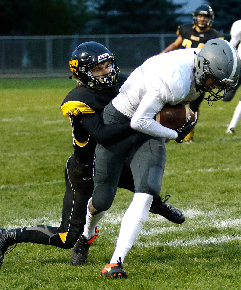 Thompson Valley's Warner Wolfgang (34) tackles Berthoud's Ryan Schmad (81) on Thursday, Sept. 28, 2017, at Patterson Field. (Photo by Lauren Cordova/Loveland Reporter-Herald)