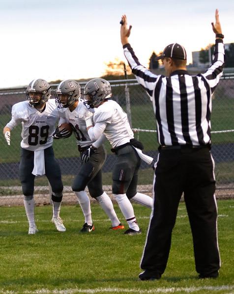 Berthoud's Jacob Rafferty (89) and Jacob Lozinski (1) congradulate Ryan Schmad (81) on scoring the first touchdown of the night on Thursday, Sept. 28, 2017, at Patterson Field. (Photo by Lauren Cordova/Loveland Reporter-Herald)