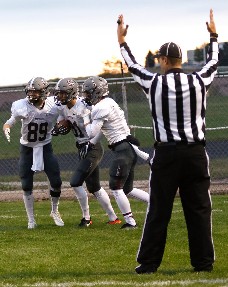 Berthoud's Jacob Rafferty (89) and Jacob Lozinski (1) congradulate Ryan Schmad (81) on scoring the first touchdown of the night on Thursday, Sept. 28, 2017, at Patterson Field. (Photo by Lauren Cordova/Loveland Reporter-Herald)