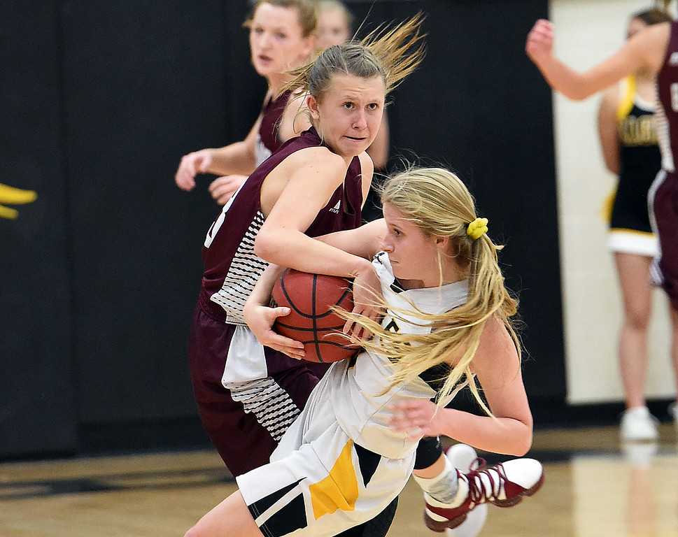 Berthoud's (13) Breanna Fowler and Thompson Valley's (3) Kyla Schuetz battle for the ball during their game Tuesday, Dec. 19, 2017, at Thompson Valley in Loveland.   (Photo by Jenny Sparks/Loveland Reporter-Herald)