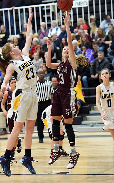 Berthoud's (13) Breanna Fowler goes up for a shots as Thompson Valley's (23) Sydnee Durtsche tries to block during their game Tuesday, Dec. 19, 2017, at Thompson Valley in Loveland.   (Photo by Jenny Sparks/Loveland Reporter-Herald)