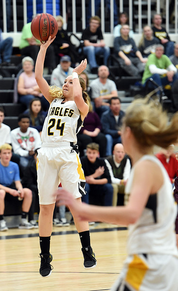 Thompson Valley's (24) Lacy Sauer goes up for a shot during their game against Berthoud Tuesday, Dec. 19, 2017, at Thompson Valley in Loveland.   (Photo by Jenny Sparks/Loveland Reporter-Herald)