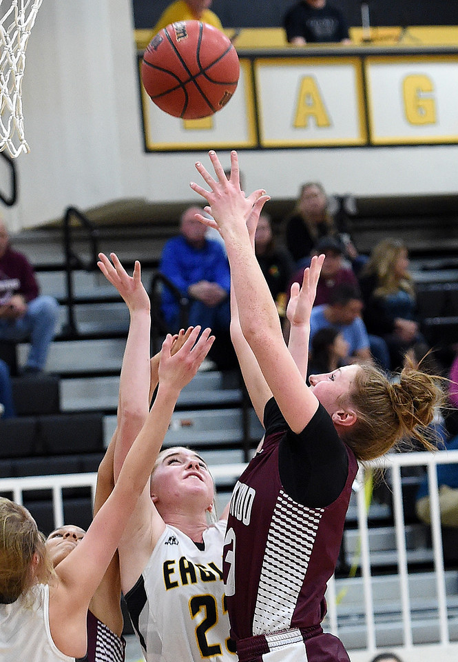 Berthoud's (3) Emily Cavey and Thompson Valley's (23) Sydnee Durtsche go up for a rebound during their game Tuesday, Dec. 19, 2017, at Thompson Valley in Loveland.   (Photo by Jenny Sparks/Loveland Reporter-Herald)