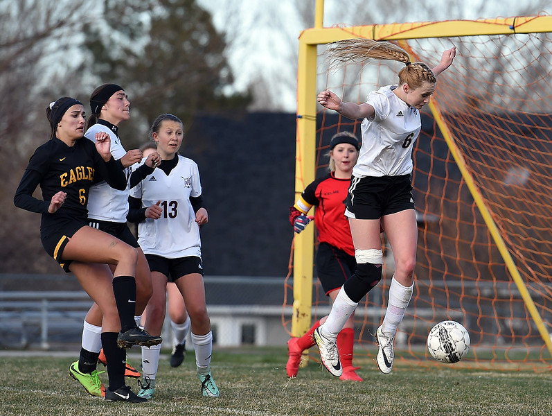 Berthoud's (6) Hailey Pepper blocks a shot during their game against Thompson Valley on Thursday, March 29, 2018, at Marr Field in Berthoud. (Photo by Jenny Sparks/Loveland Reporter-Herald)