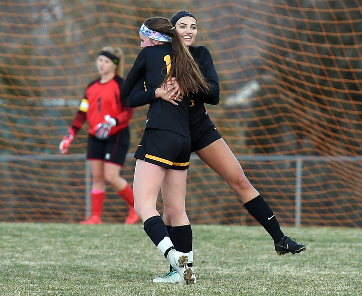 Thompson Valley's (10) Kahrena Thompson, left, and (6) Kaili Campbell celebrate Thompson's goal during their game against Berthoud on Thursday, March 29, 2018, at Marr Field in Berthoud. (Photo by Jenny Sparks/Loveland Reporter-Herald)